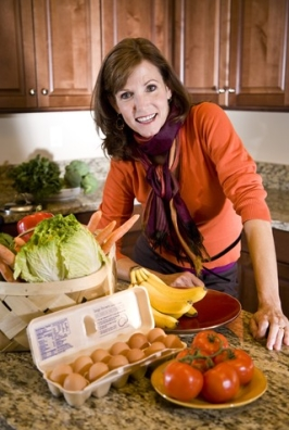 http://www.dreamstime.com/royalty-free-stock-photography-mature-woman-kitchen-fresh-produce-image11754017